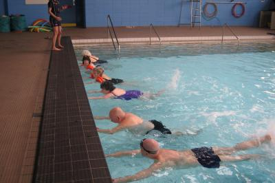 group of people about to go for a swim in a leisure center pool